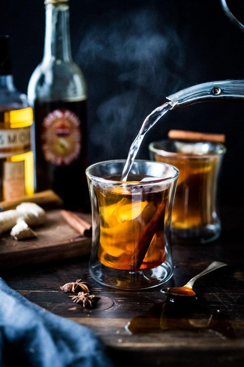 """<p>A hot toddy will lift your spirits on a rainy fall day—especially this version that's sweetened with maple syrup.</p><p><strong>Get the recipe at <a href=""""https://www.feastingathome.com/maple-ginger-hot-toddy/"""" rel=""""nofollow noopener"""" target=""""_blank"""" data-ylk=""""slk:Feating at Home"""" class=""""link rapid-noclick-resp"""">Feating at Home</a>.</strong></p><p><strong><a class=""""link rapid-noclick-resp"""" href=""""https://go.redirectingat.com?id=74968X1596630&url=https%3A%2F%2Fwww.walmart.com%2Fbrowse%2Fthe-pioneer-woman-kitchen-appliances%2Fc2hlbGZfaWQ6ODEwOQieie&sref=https%3A%2F%2Fwww.thepioneerwoman.com%2Ffood-cooking%2Fmeals-menus%2Fg33510531%2Ffall-cocktail-recipes%2F"""" rel=""""nofollow noopener"""" target=""""_blank"""" data-ylk=""""slk:SHOP ELECTRIC KETTLES"""">SHOP ELECTRIC KETTLES</a><br></strong></p>"""
