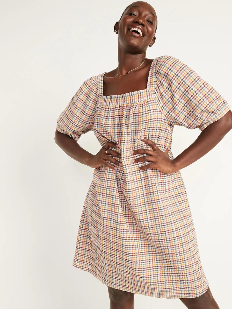 <p>Trust us, this <span>Old Navy Textured Dobby-Gingham Puff-Sleeve Swing Dress</span> ($45) is so comfortable and easy to wear. All you need to add is a denim jacket.</p>