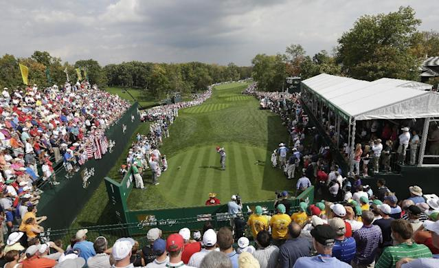 United States' Phil Mickelson tees off on the first hole during a foursome match against the International team at the Presidents Cup golf tournament at Muirfield Village Golf Club Friday, Oct. 4, 2013, in Dublin, Ohio. (AP Photo/Darron Cummings)