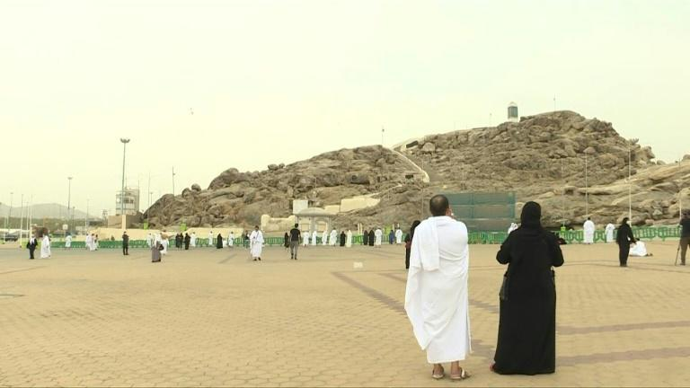 Pilgrims gather to pray next to Saudi Arabia's Mount Arafat, a key ritual in the hajj pilgrimage. Access to climb the mountain is forbidden this year due to Covid-19, with the pilgrimage taking place in downsized form for the second year running.