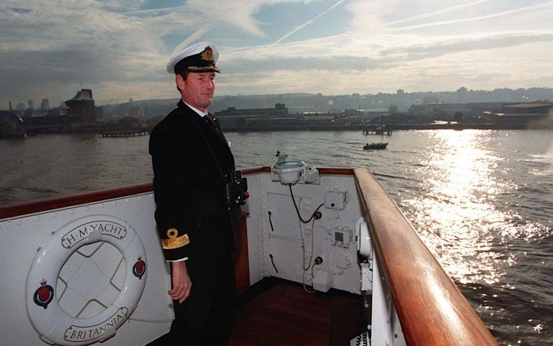 Commodore Tony Morrow of the Royal Navy on board the Royal Yacht Britannia as it sails down the River Thames on its last official voyage - Credit: PA Archive/Press Association Images/PA Archive/Press Association Images