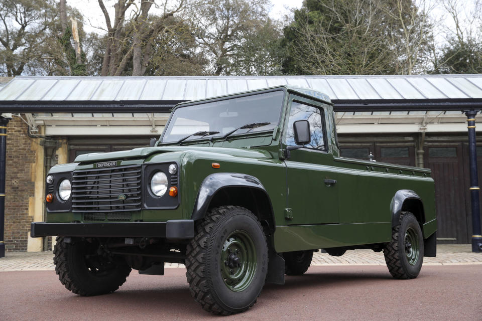The Land Rover Defender that will be used to transport the coffin of Britain's Prince Philip, Duke of Edinburgh during the funeral procession is parked in Windsor Castle, Windsor on April 14, 2021. - The modified Land Rover Defender TD5 130 chassis cab vehicle was made at Land Rover's Solihull factory in 2003 and the Duke oversaw the modifications requesting a repaint in military green and designing the open top rear and special