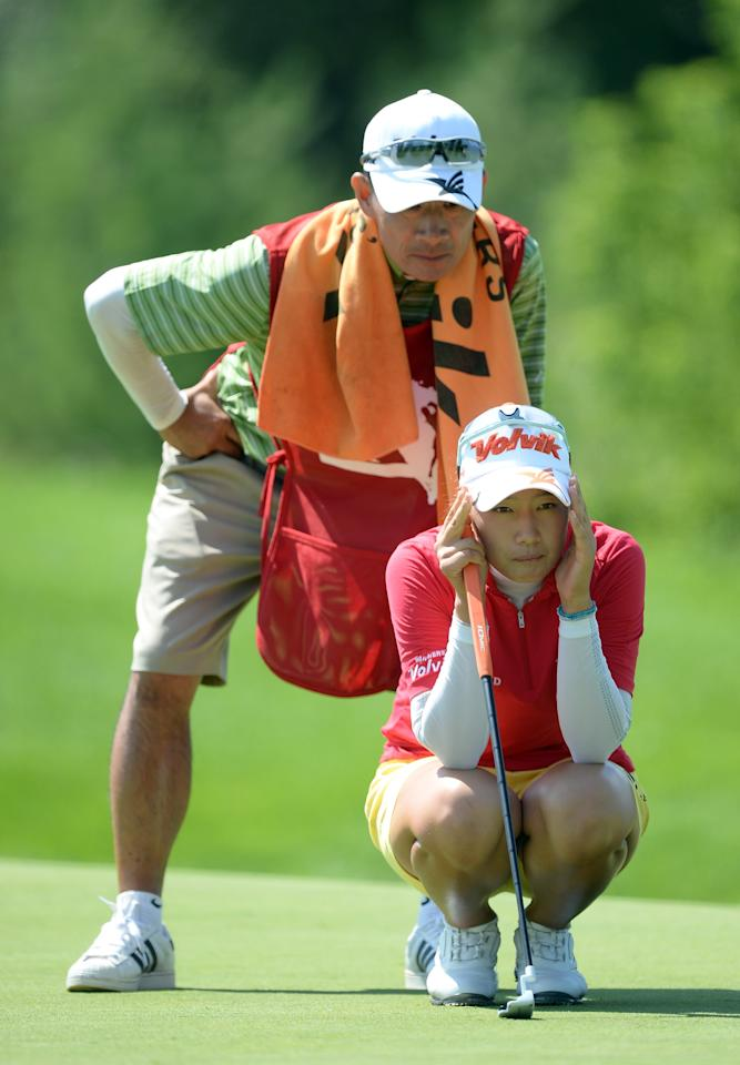 WATERLOO, CANADA - JULY 12: Chella Choi of South Korea lines up her putt with her father and caddie Jiyeon Choi on the third green during round two of the Manulife Financial LPGA Classic at the Grey Silo Golf Course on July 12, 2013 in Waterloo, Canada. (Photo by Harry How/Getty Images)