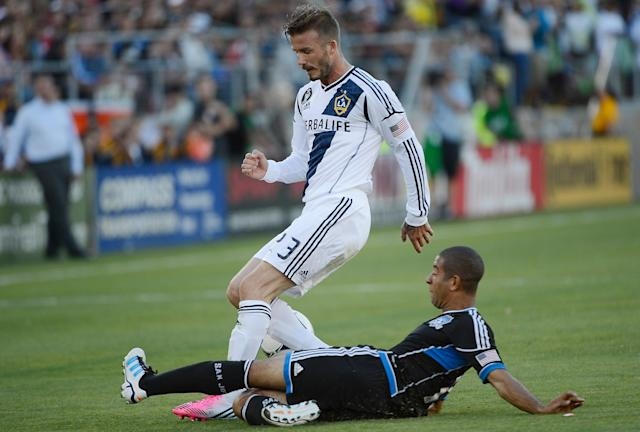 PALO ALTO, CA - JUNE 30: David Beckham #23 of the Los Angeles Galaxy battles for control of the ball with Justin Morrow #15 of the San Jose Earthquakes in the first half of their MLS soccer game at Stanford Stadium on June 30, 2012 in Palo Alto, California. (Photo by Thearon W. Henderson/Getty Images)