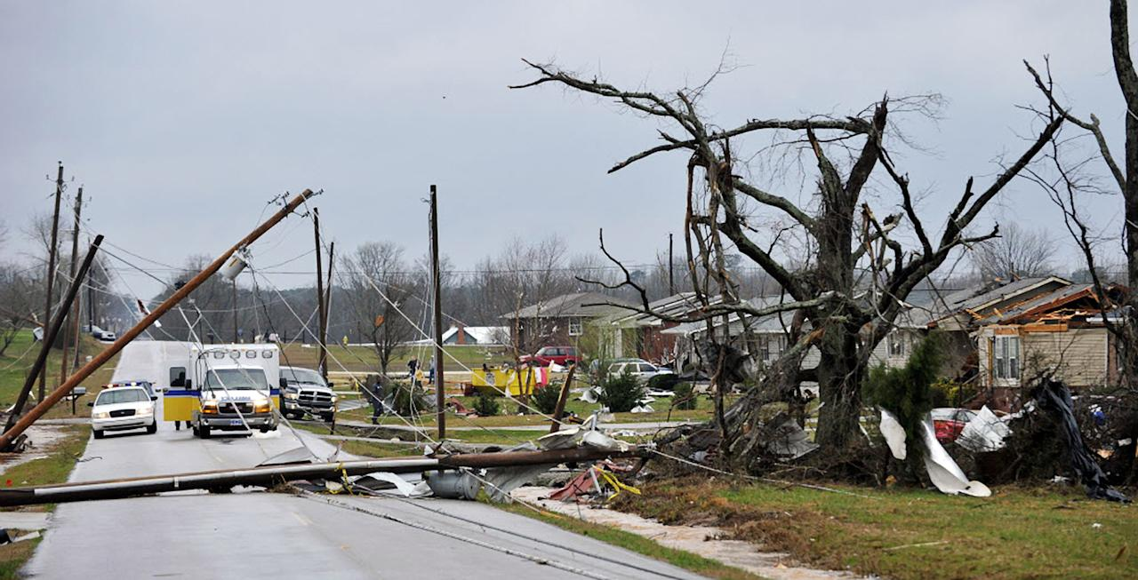 Downed power lines and debris caused by a reported tornado lie along Yarbrough Road, Friday, March 2, 2012, in Harvest, Ala. (AP Photo/The Huntsville Times, Bob Gathany)