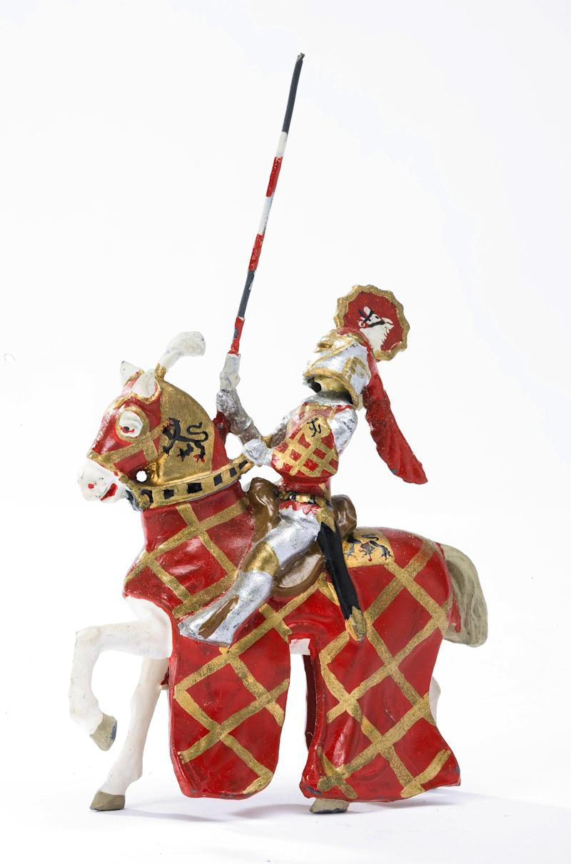 This undated photo provided by Sotheby's New York shows a 3-inch figure of a medieval mounted knight brandishing a javelin which is part of a collection that has been on display for the past 25 years in the lobby of the Forbes Magazine Fifth Avenue headquarters in New York. The Forbes collection of miniature antique toy boats, luxury ships, soldiers, cowboys and American Indians, and games will be auctioned Dec. 17 at Sotheby's New York galleries. It is comprised of thousands of pieces made from the 1870s through the 1950s. (AP Photo/Sotheby's New York)  NO SALES