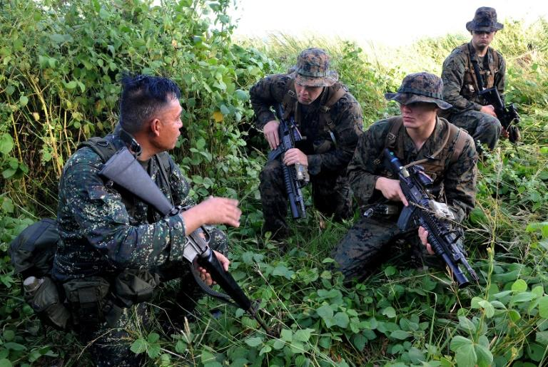 US Marines and their Philippine counterparts inspect a hill during joint military training exercises in Cavite, south of Manila on October 11, 2010