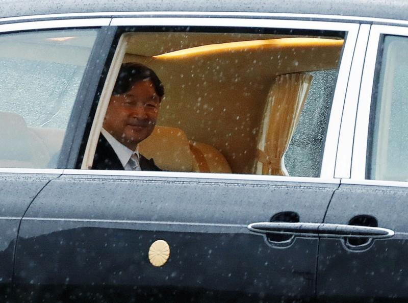 Japan's Emperor Naruhito arrives at the Imperial Palace on the day he is formally enthroned, in Tokyo