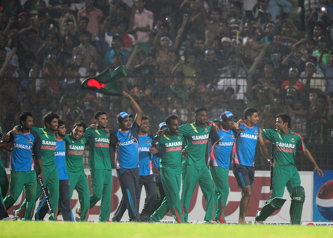 Bangladesh cricketers celerbate after winning the third One-Day International (ODI) cricket match between Bangladesh and New Zealand at Khan Jahan Ali Stadium in Fatullah on the outskirts of Dhaka on November 3, 2013 . Bangladesh win the series against New Zealand by 3-0. AFP PHOTO/ Munir uz ZAMAN        (Photo credit should read MUNIR UZ ZAMAN/AFP/Getty Images)