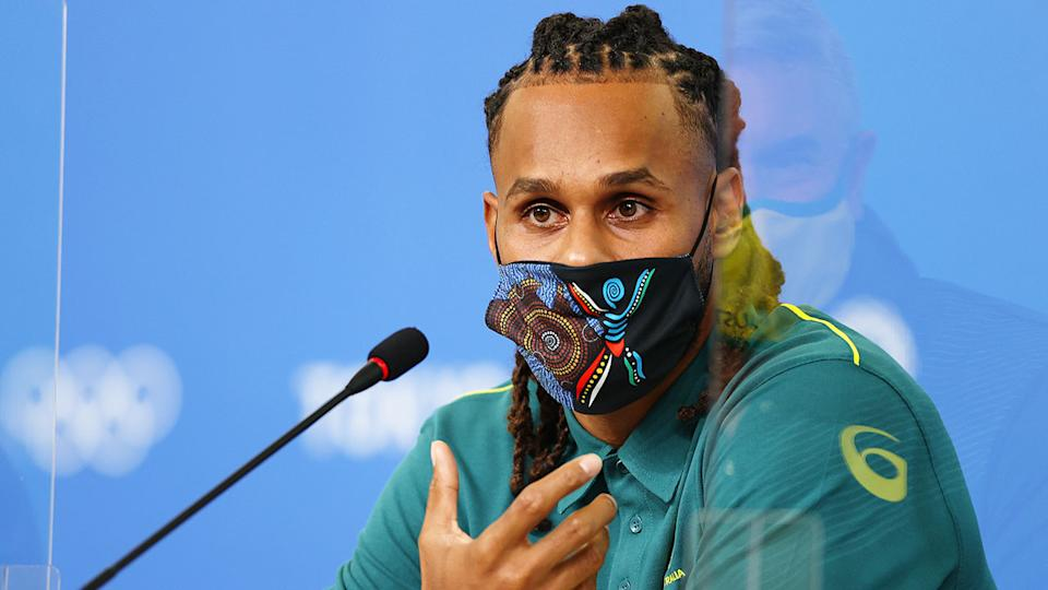 Pictured here, Patty Mills speaks to reporters at an Olympic Games press conference in Tokyo.