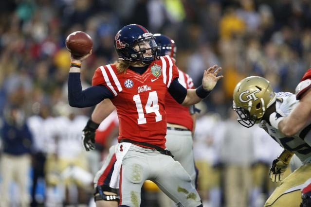 NASHVILLE, TN - DECEMBER 30: Bo Wallace #14 of the Ole Miss Rebels passes the ball against the Georgia Tech Yellow Jackets during the Franklin American Mortgage Music City Bowl at LP Field on December 30, 2013 in Nashville, Tennessee. Ole Miss won the game 25-17. (Photo by Joe Robbins/Getty Images)