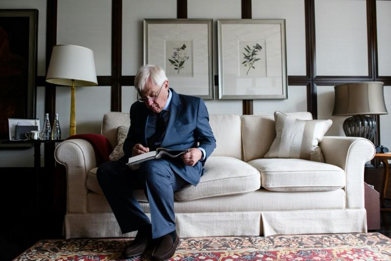 "Hong Kong's former British colonial governor Chris Patten signs his new memoir ""First Confession"" after an interview with AFP at the harbourside Mandarin Oriental hotel in Hong Kong on September 21, 2017"