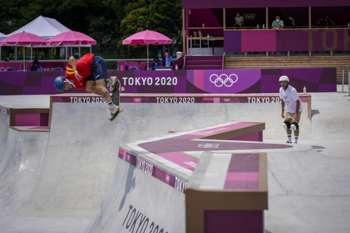Dallas Oberholzer, 46, right, from South Africa, watches as other skaters practice in a men's Park Skateboarding training session at the 2020 Summer Olympics, Saturday, July 31, 2021, in Tokyo, Japan. The age-range of competitors in skateboarding's Olympic debut at the Tokyo Games is remarkably broad and 46-year-old Dallas Oberholzer will go wheel-to-wheel with skaters less than half his age. (AP Photo/Ben Curtis)