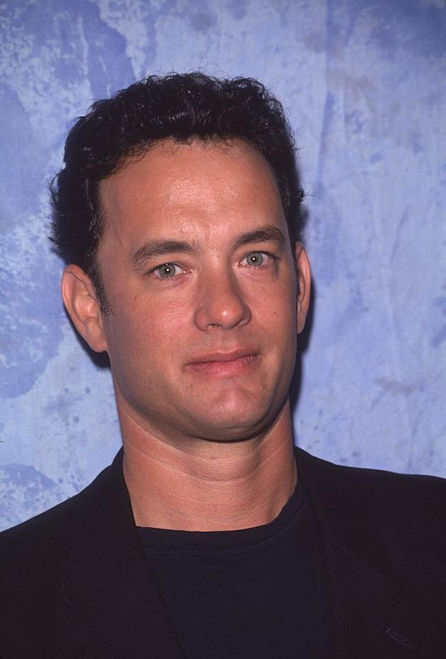 """<p>Hanks and then-wife Samantha Lewes had their son, Colin, when Hanks was 21. Here is Hanks in 1996, the year he made his directing debut with """"That Thing You Do!""""  </p>"""