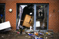 A man surveys a damaged house after flooding in Ensival, Verviers, Belgium, Friday July 16, 2021. Severe flooding in Germany and Belgium has turned streams and streets into raging torrents that have swept away cars and caused houses to collapse. (AP Photo/Francisco Seco)