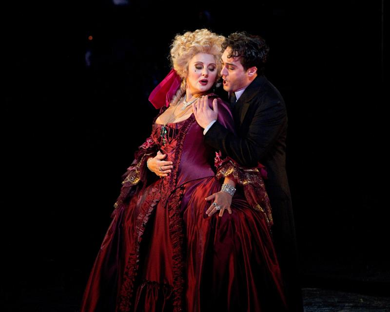 """This photo provided by the Metropolitan Opera, shows Enkelejda Shkosa as Giuletta and Giuseppe Filianoti in the title role of Offenbach's """"Les Contes d'Hoffmann,"""" during a rehearsal Sept. 21, 2010, at the Metropolitan Opera in New York. (AP Photo/Marty Sohl)"""