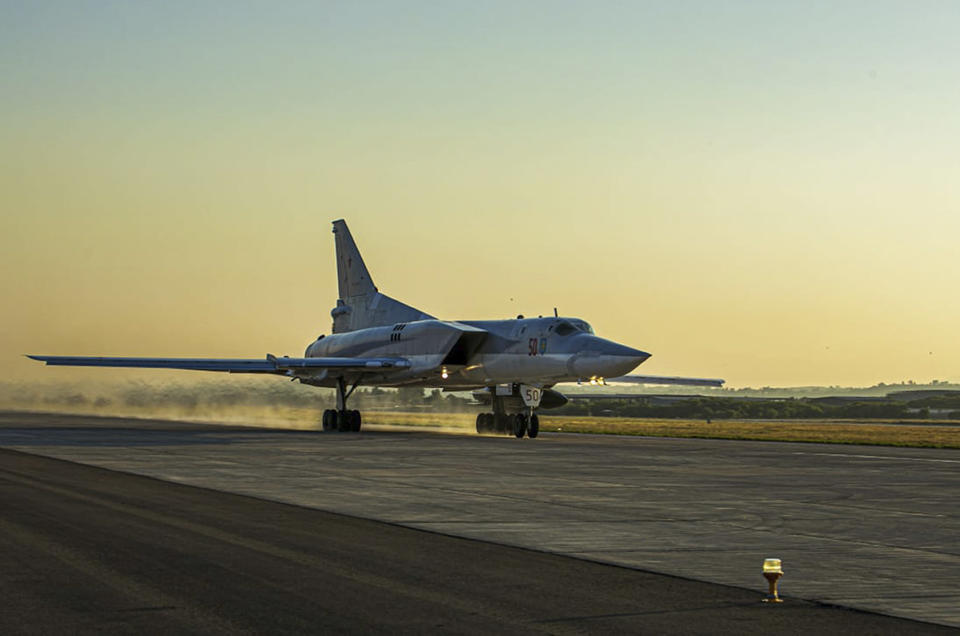 In this photo released by Russian Defense Ministry Press Service on Friday, June 25, 2021, a Tu-22M3 bomber of the Russian air force takes off from the Hemeimeem air base in Syria. The Russian military on Friday launched sweeping maneuvers in the Mediterranean Sea featuring warplanes capable of carrying hypersonic missiles, a show of force amid a surge in tensions following an incident with a British destroyer in the Black Sea. (Russian Defense Ministry Press Service via AP)