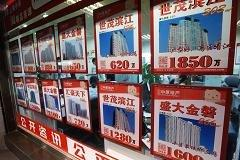 China's home prices ease, developers tumble