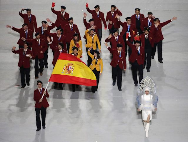 Javier Fernandez of Spain holds the national flag and enters the arena with his teammates during the opening ceremony of the 2014 Winter Olympics in Sochi, Russia, Friday, Feb. 7, 2014