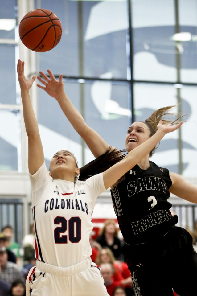 Robert Morris' Honoka Ikematsu (20) shoots as St. Francis (Pa)'s Karson Swogger defends during the first half of an NCAA college basketball game for the championship of the Northeast Conference women's tournament, Sunday, March 17, 2019, in Moon, Pa. (AP Photo/Keith Srakocic)