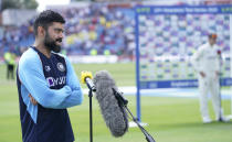 India's captain Virat Kohli, left, and England captain Joe Root, right, speak during the presentation ceremony after England won the third test cricket match between England and India, at Headingley cricket ground in Leeds, England, Saturday, Aug. 28, 2021. (AP Photo/Jon Super)