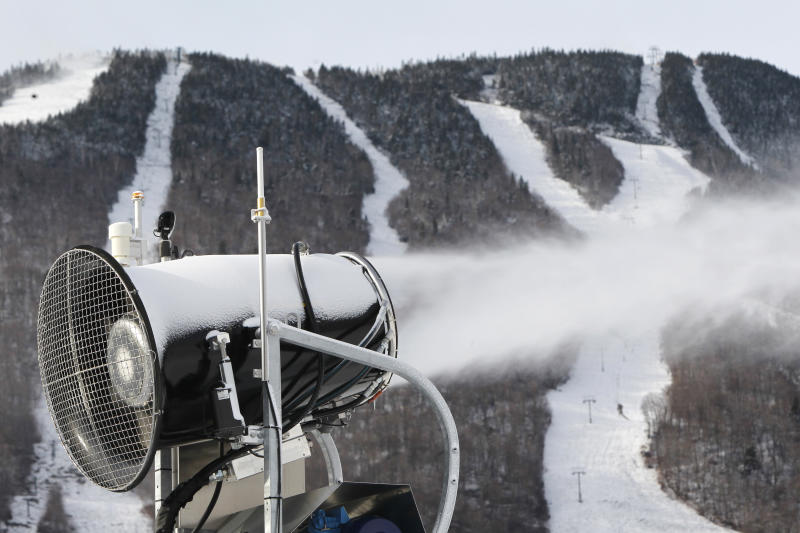 This Nov. 15, 2012 file photo shows a snow gun making fresh snow at the Stowe resort in Stowe, Vt. The ground might be bare, but ski areas across the Northeast are making big investments in high-efficiency snowmaking so they can open more terrain earlier and longer. (AP Photo/Toby Talbot)