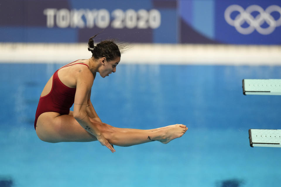 Pamela Ware of Canada competes in women's diving 3m springboard semifinal at the Tokyo Aquatics Centre at the 2020 Summer Olympics, Saturday, July 31, 2021, in Tokyo, Japan. (AP Photo/Dmitri Lovetsky)