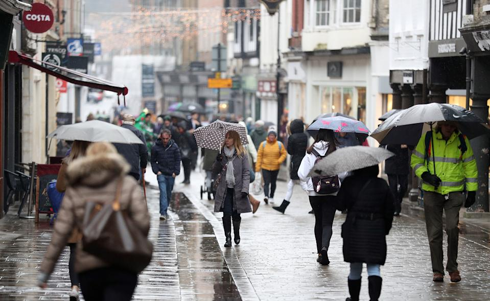 EMBARGOED TO 0001 MONDAY MAY 20 File photo dated 27/11/2018 of shoppers on a High Street. The number of takeovers in the UK's retail sector tumbled over the past year, as Brexit uncertainty clouds the future of the high street.