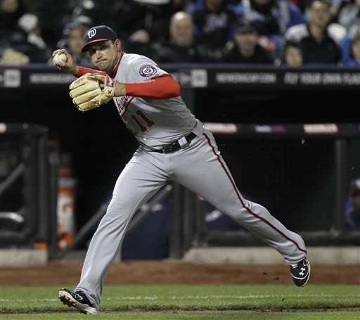Washington Nationals third baseman Ryan Zimmerman throws out New York Mets' Daniel Murphy on a ground ball during the third inning of a baseball game in New York, Monday, April 9, 2012. (AP Photo/Kathy Willens)