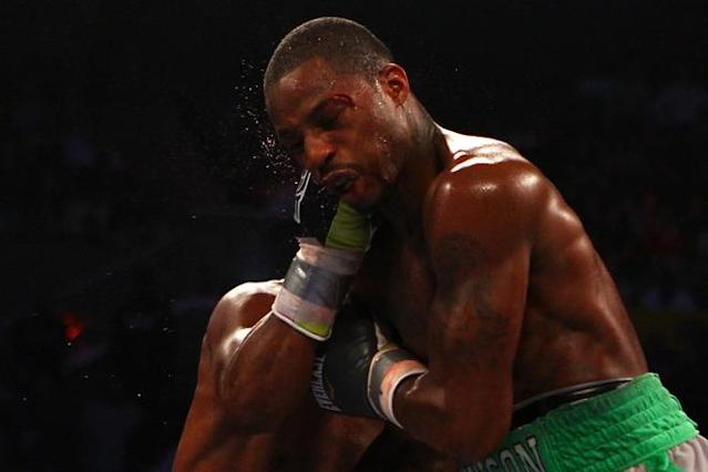 ATLANTIC CITY, NJ - APRIL 28: Chad Dawson takes a punch to the face from Bernard Hopkins during their WBC & Ring Magazine Light Heavyweight Title fight at Boardwalk Hall Arena on April 28, 2012 in Atlantic City, New Jersey. (Photo by Al Bello/Getty Images)