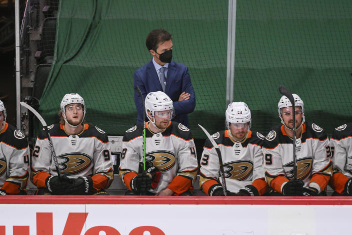 Anaheim Ducks coach Dallas Eakins watches the team play against the Minnesota Wild during the second period of an NHL hockey game Saturday, May 8, 2021, in St. Paul, Minn. The Wild won 4-3 in overtime. (AP Photo/Craig Lassig)