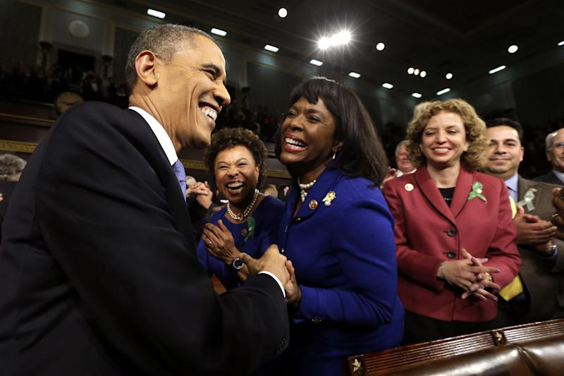 President Barack Obama is greeted by Rep. Barbara Lee, D-Calif., second from left, Rep. Terri Sewell, D-Ala., and Rep. Debbie Wasserman Schultz, D-Fla., right, before giving his State of the Union address during a joint session of Congress on Capitol Hill in Washington, Tuesday Feb. 12, 2013. (AP Photo/Charles Dharapak, Pool)
