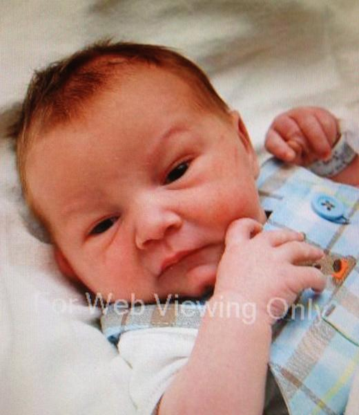 """This undated photo provided by the Memorial Hermann The Woodlands Hospital via the Montgomery County Sheriff's Office shows a newborn baby boy who was abducted from his screaming mother after she was repeatedly shot outside a suburban Houston pediatric center on Tuesday, April 17, 2012. The infant was wearing a green-and-white one-piece outfit displaying the word """"handsome."""" (AP Photo/Montgomery County Sheriff's Office)"""