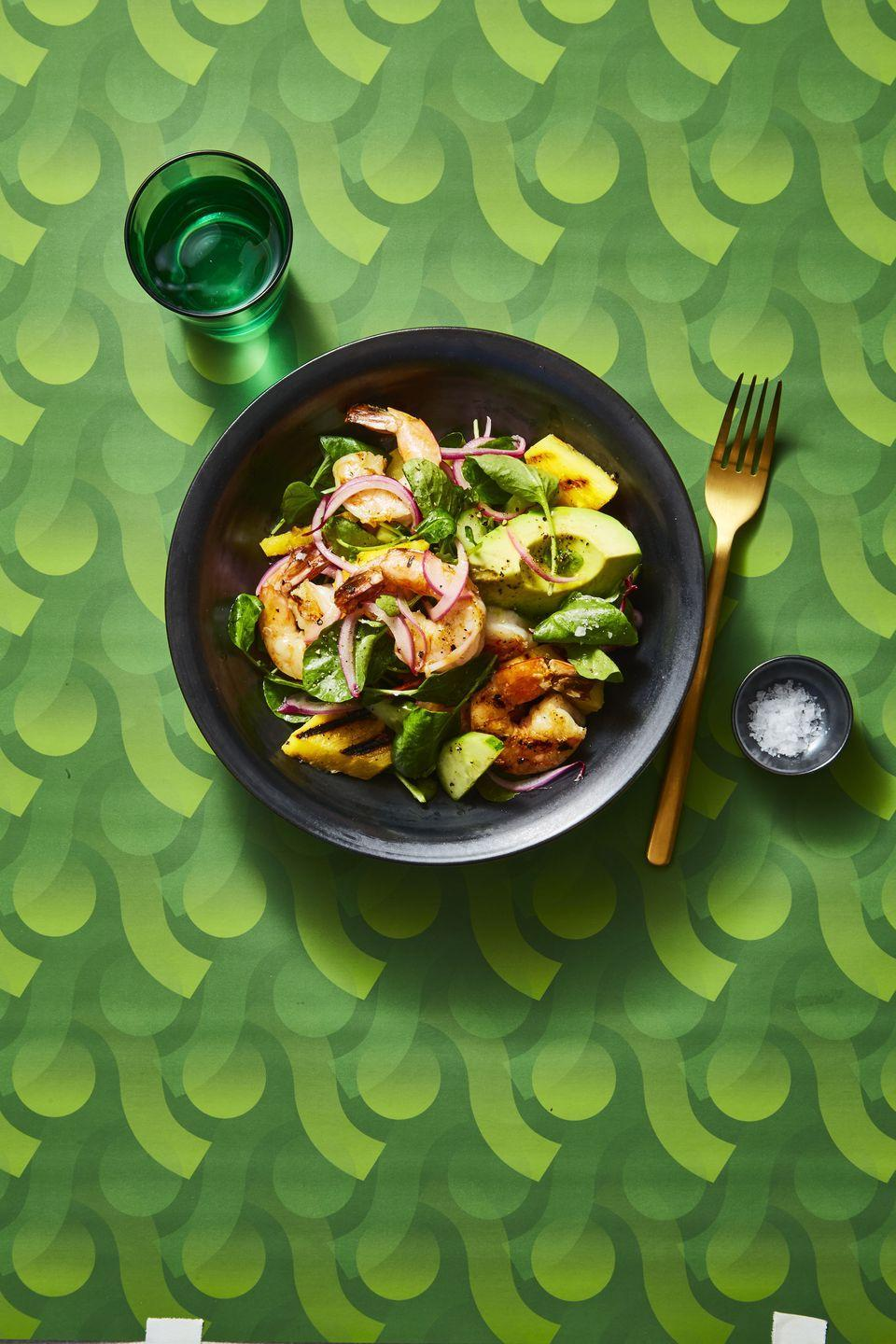 """<p>Perfectly grilled shrimp can be fired up in just a few minutes. But a bit of knife work for fresh avocado and pineapple make this 20-minute entrée taste like a trip to the tropics.</p><p><em><a href=""""https://www.goodhousekeeping.com/food-recipes/easy/a25656053/charred-shrimp-and-avocado-salad-recipe/"""" rel=""""nofollow noopener"""" target=""""_blank"""" data-ylk=""""slk:Get the recipe for Charred Shrimp and Avocado Salad »"""" class=""""link rapid-noclick-resp"""">Get the recipe for Charred Shrimp and Avocado Salad »</a></em></p>"""