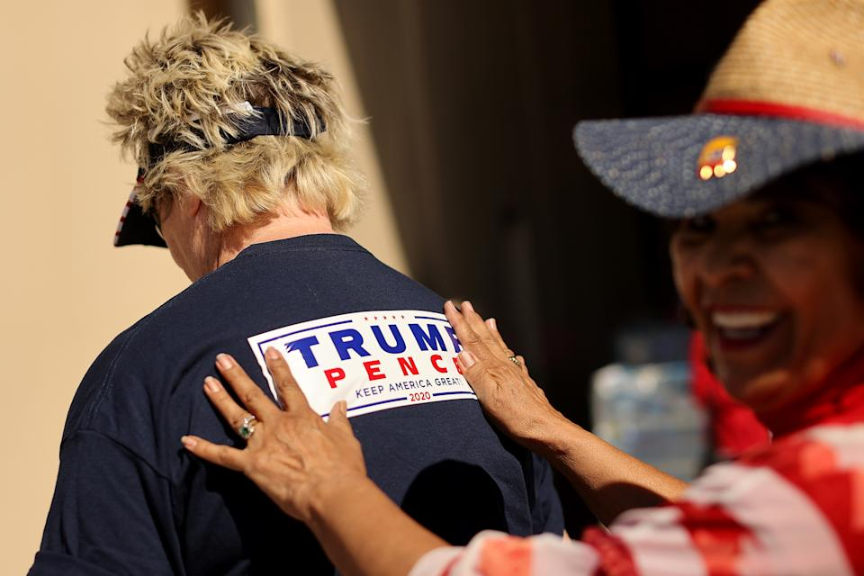 GOODYEAR, ARIZONA - OCTOBER 28: Supporters of U.S. President Donald Trump attend a campaign rally with Tru at Phoenix Goodyear Airport October 28, 2020 in Goodyear, Arizona. With less than a week until Election Day, Trump and his opponent, Democratic presidential nominee Joe Biden, are campaigning across the country. (Photo by Chip Somodevilla/Getty Images)