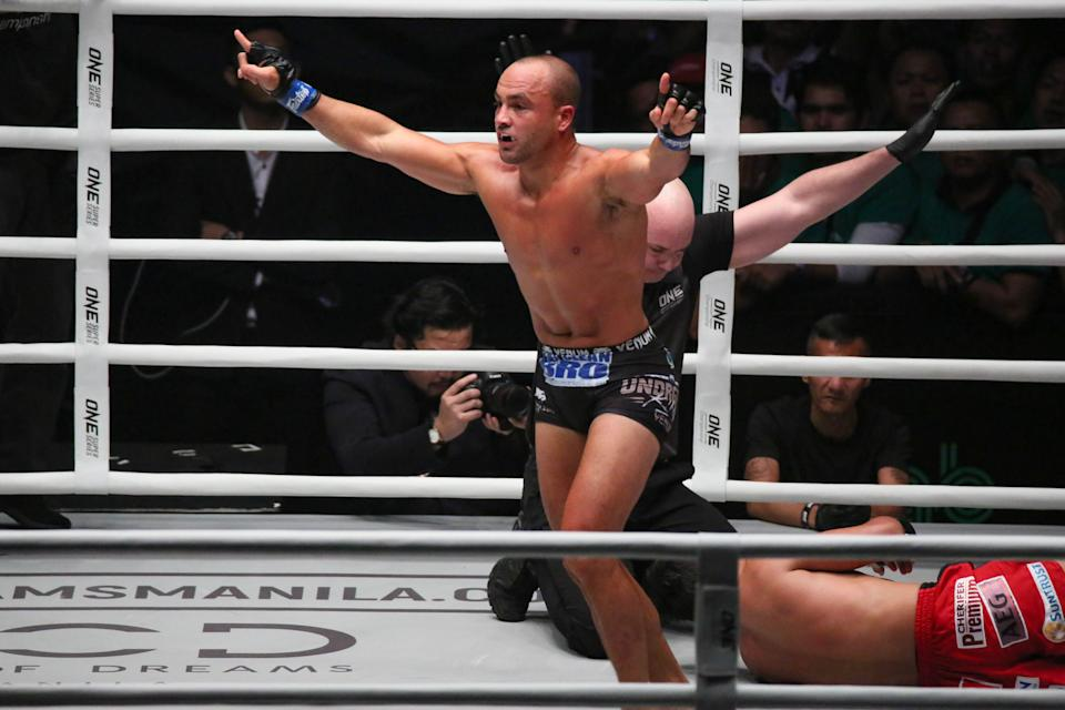 Eddie Alvarez of the USA submits Eduard Folayang of the Philippines during their match for the ONE Championship Dawn of Heroes event held at the Mall of Asia Arena in Pasay City, south of Manila on August 02, 2019. (Photo by George Calvelo/NurPhoto via Getty Images)