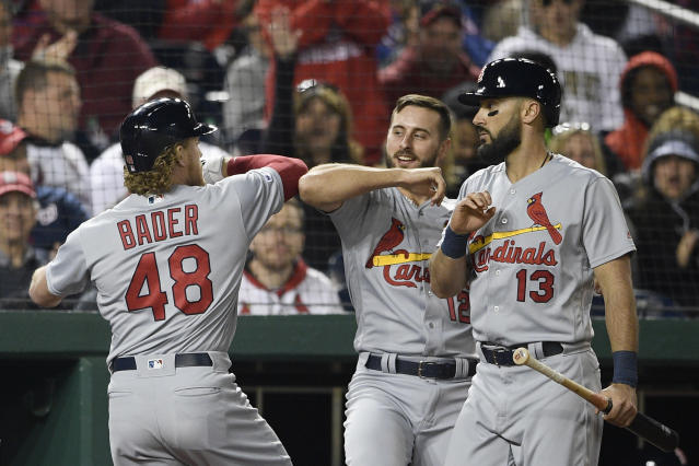 St. Louis Cardinals' Harrison Bader (48) celebrates his home run with Paul DeJong (12) and Matt Carpenter (13) during the fifth inning of a baseball game against the Washington Nationals, Monday, April 29, 2019, in Washington. (AP Photo/Nick Wass)