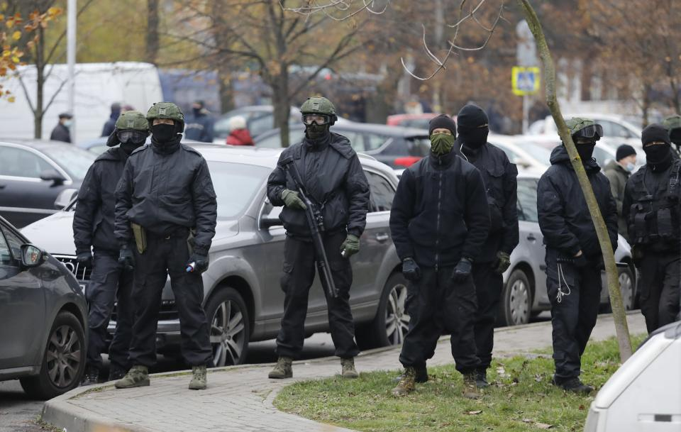 Belarusian riot police prepare to block demonstrators during an opposition rally to protest the official presidential election results in Minsk, Belarus, Sunday, Nov. 15, 2020. Protests have rocked Belarus since the August election that official results say gave Lukashenko a sixth term in office but that opponents and some polls workers claim were manipulated. (AP Photo)