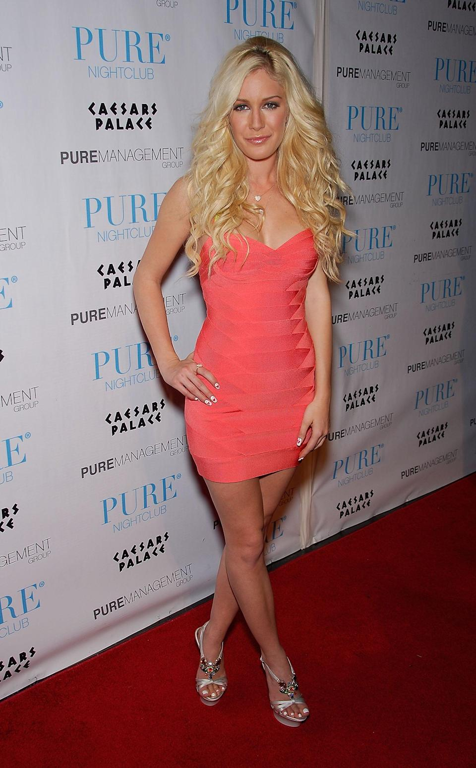 <p>Heidi showed off the going-out uniform in a barely there bandage dress and platform heels. </p>
