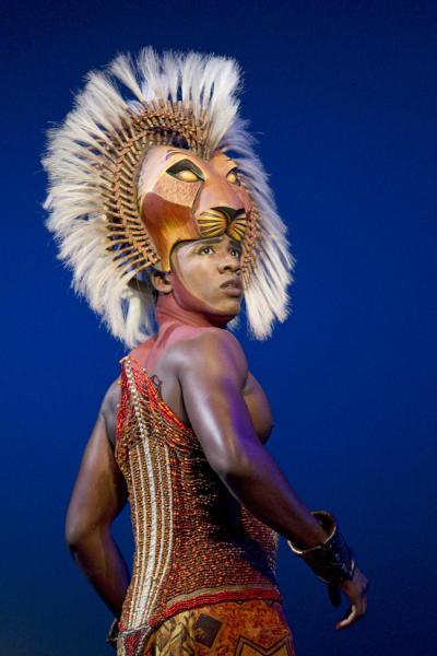 """In this theater publicity image released by Disney Theatrical Productions, Dashaun Young portrays Simba in the Broadway production of """"The Lion King,"""" in New York. The Lion King"""" has more reason to roar - it's on pace to end the week as the first Broadway show to earn $1 billion. (AP Photo/Disney Theatrical Productions, Joan Marcus, File)"""