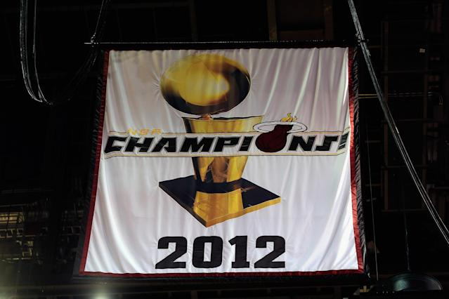 MIAMI, FL - OCTOBER 30: The Miami Heat 2012 NBA Championship banner is raised at the American Airlines Arena prior to the game against the Boston Celtics on October 30, 2012 in Miami, Florida. NOTE TO USER: User expressly acknowledges and agrees that, by downloading and/or using this Photograph, user is consenting to the terms and conditions of the Getty Images License Agreement. (Photo by Chris Trotman/Getty Images)