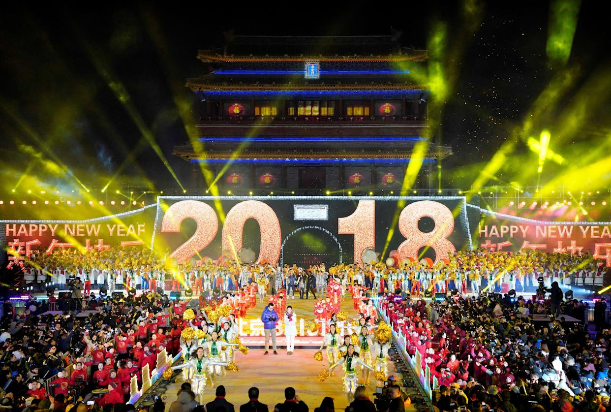 People celebrate the New Year during a countdown event at Yongdingmen Gate in Beijing, China on January 1, 2018. (Photo: Jason Lee / Reuters)