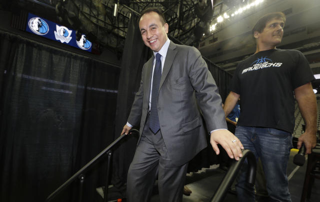 New Dallas Mavericks general manager Gersson Rosas walks off the stage after a news conference introducing free agents signed to the NBA basketball team in the offseason, Thursday, Aug. 15, 2013, in Dallas. (AP Photo/LM Otero)