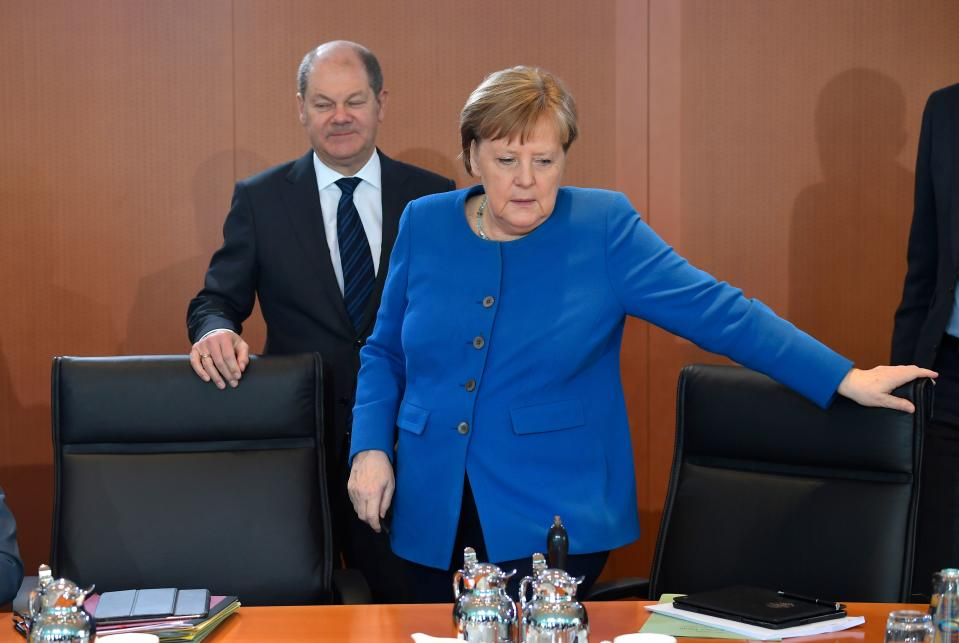 German Chancellor Angela Merkel and German Finance Minister and Vice-Chancellor Olaf Scholz arrive for the weekly cabinet meeting on March 11, 2020 at the Chancellery in Berlin. (Photo by Tobias SCHWARZ / AFP) (Photo by TOBIAS SCHWARZ/AFP via Getty Images)