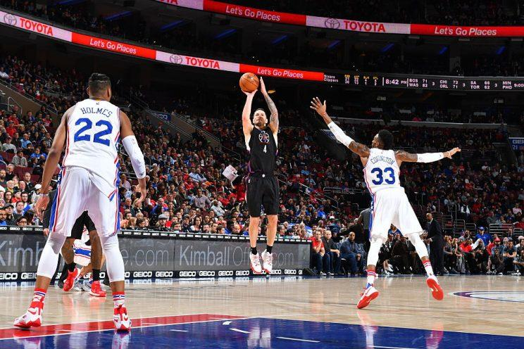 J.J. Redick shows Robert Covington and Richaun Holmes how he can help. (Getty Images)