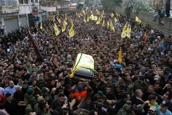 Members and supporters of Lebanon's Shiite militant group Hezbollah carry the coffin of top military commander Mustafa Badreddine during his funeral in southern Beirut on May 13.