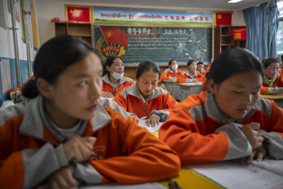Students recite vocabulary during a Mandarin Chinese class at Nagqu No. 2 Senior High School, a public boarding school for students from northern Tibet, in Lhasa in western China's Tibet Autonomous Region, as seen during a rare government-led tour of the region for foreign journalists, Tuesday, June 1, 2021. Long defined by its Buddhist culture, Tibet is facing a push for assimilation and political orthodoxy under China's ruling Communist Party. (AP Photo/Mark Schiefelbein)