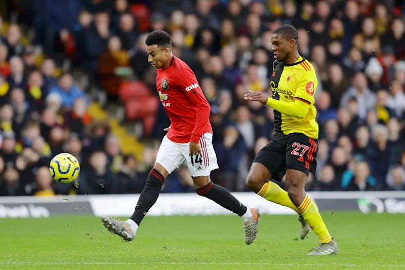 WATFORD, ENGLAND - DECEMBER 22: Jesse Lingard of Manchester United misses a chance as he is challenged by Christian Kabasele of Watford during the Premier League match between Watford FC and Manchester United at Vicarage Road on December 22, 2019 in Watford, United Kingdom. (Photo by Richard Heathcote/Getty Images)