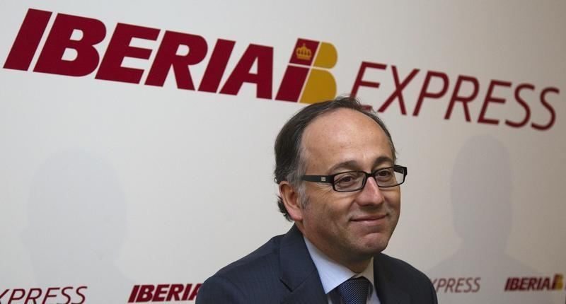 Iberia Express CEO Gallego smiles during a news conference in Madrid
