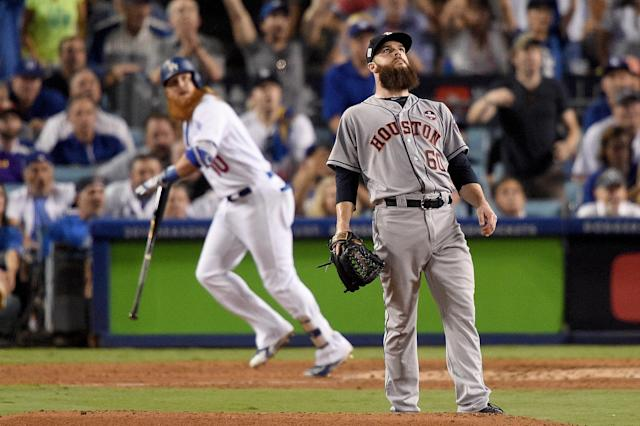 <p>Dallas Keuchel #60 of the Houston Astros reacts after allowing a two-run home run to Justin Turner #10 of the Los Angeles Dodgers during the sixth inning in game one of the 2017 World Series at Dodger Stadium on October 24, 2017 in Los Angeles, California. (Photo by Kevork Djansezian/Getty Images) </p>